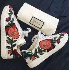 Gucci new ace floral sneakers.