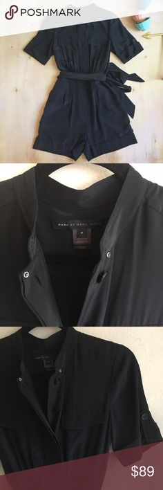 """Marc by Marc Jacobs Stara Silk Romper Effortlessly chic and comfortable Marc by Marc Jacobs black silk romper with short sleeves, front pleated and cuffed shorts, and attached dramatic ribbon belt. Belt can be tied in front or back. Hidden buttons up the front. Size 2. 4"""" inseam. See additional measurements in pics. In great used condition. Only flaw I see is a couple tiny pills where the belt attaches in back. Marc By Marc Jacobs Pants Jumpsuits & Rompers"""