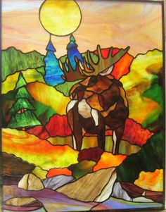Stained glass moose panel. Looks like a beautiful fall morning wherever this moose is!