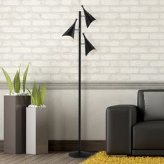 Awash in urbane appeal, this task floor lamp brings a sophisticated touch to your decor. Add vintage-inspired clocks and artful landscape prints for a polished home office , or group it with scrolling mirrors, elegant pillows, and equestrian accents for a refined master suite. Pair this sleek and shimmering lamp with rich leather furniture and warm wood bookcases to craft a handsome library vignette, or add it to a sleek modern console table to contrast traditional with contemporary. Black…