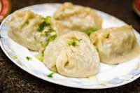 Manty are steamed dumplings with spiced meat mixture, usually lamb or ground beef, in a dough wrapper. Vegeterian ones are usually with pumpkin.