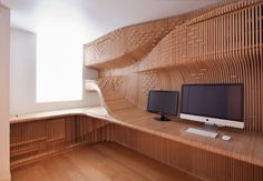 A carefully detailed private workspace conceals office equipment behind birch plywood ribs // Designer: Synthesis Design + Architecture // Fabricator: Cutting Edge  // photo: Peter Guenzel