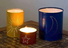 Velas en latas metalicas perforadas a su gusto y pintadas de diferentes colores