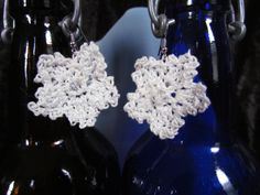 Crochet star earrings. White with white clear bead on French hooks.  1 ½ inch (3.8cm) in size. Looking for best offer. I have two pair of these.