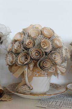 You can see the two bouquets I have made using the the tea cups and text pages from Jane's novels. The first one was made using a newer white paged book, which gives it that shabby chic and deliciously modern feel. The second arrangement is made with a more vintage and nostalgic appeal. Just by changing the colour of your paper, you can change the styling.
