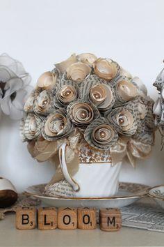 Paper rose arrangement in a teacup. Very cute!