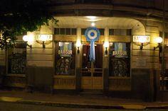 """""""""""BAR SUR"""""""" Bar Notable, ubicada en el casco historico de San Telmo, es del 1910. Tal cual como era de esa epoca, el ambiente es intimista. Su piso de damero, blanco y negro, sus mesas y sillas de madera estilo vienes, y con una antiquisima moledora de cafe y maquina de cafe""""""""Omega"""""""". Hoy en la actualidad, por la noche ofrece shows de tango"""