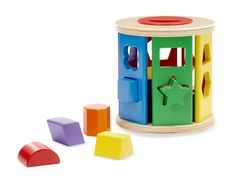 Match & Roll Shape Sorter : This brightly colored wooden shape sorter is an exciting update on a classic toy! Toddlers can drop the dozen-plus vibrant wooden shapes--including a triangle, octagon, star, rectangle, square, trapezoid, hexagon--through the color-matched holes, then roll the drum along, open the lid, and start all over again. An early-learning powerhouse that encourages color and shape recognition, manual dexterity, and more!