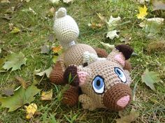 Pokemon Inspired: Rockruff Amigurumi Crochet by TheTallGrass  Handmade plushie (in crochet Amigurumi style) of the newest puppy Pokemon, Rockruff, from the Alola region!  Rockruff measures 10in long, 6in tall (with his tail) and 7in wide. He is stuffed with polyfil stuffing and his eyes and nose are needle-felted on, all other details are done in crochet :) His ears also have a small bit of wiring inside so they can be bent and moved.  Rockruff takes about 4-5 days to complete, so please a