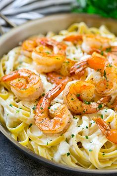 Shrimp alfredo pasta with creamy fettuccine, and sauteed shrimp.