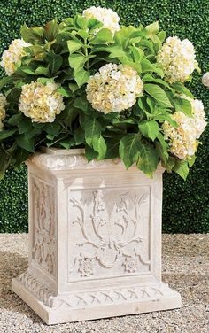 Inspired by the romantic grandeur of historical Provencal gardens, our eye-catching, all-weather planters feature gorgeously detailed designs including botanical motifs, ribbon laurels and artfully molded rims. The sturdy pulverized stone and polyresin construction ensures it will be a staple for showcasing flowers, grasses and topiaries for years to come. Topiaries, Grand Entrance, Grasses, Natural Stones, Floral Wreath, Planters, Ribbon, Gardens, Weather