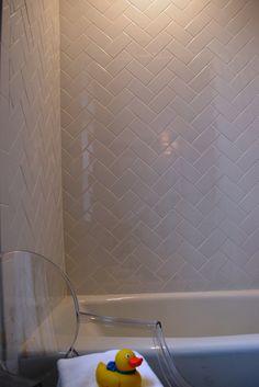 Subway tiles in herringbone pattern  http://tiledaily.com/2012/04/05/colori-assorted-ceramic-bricks/