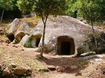 "Domus de Janas (Sardinian: ""House of the Fairies"" or of the ""Witches"") are a type of pre-Nuragic chamber tombs found in Sardinia. They consist of several chambers quarried out by the people of the San Ciriaco through Ozieri cultures and subsequent cultures, resembling houses in their layout"