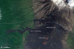 In visible light, fresh lava flows are difficult to distinguish from the black rock of Tolbachinsky Dol, a volcanic plateau on Russia's Kamchatka Peninsula. The high altitude and northern latitude of the plateau (as far north as Moscow) preserve the barren landscape left behind by past eruptions. In contrast, the fresh lava stands out clearly against the vivid green of low-elevation meadows and forest.