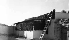 House with chili ristras drying, Isleta Pueblo, New Mexico, ca. 1930. Palace of the Governors Photo Archives 068783.