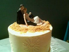 Top of my wedding cake! Bride & Groom together. Beach theme wedding. Vanilla wafers can be used for the sandy texture.