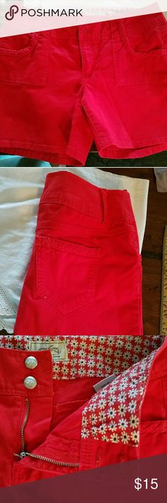 Red shorts Authentic Denim Red Shorts.Braiding detail on front and back pockets. Two buttons and zipper front. 98% cotton  2% spandex  Waist 32  Rise 9  Inseam 5 Excellent condition! Shorts