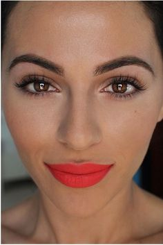 Orangey red lips with soft brown eyeliner