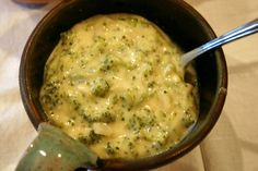 Broccoli Cheese Soup for the Crock Pot  1/2 cup green pepper, chopped 1/2 cup onion, chopped 2 tablespoons butter or 2 tablespoons margarine 1 (10 ounce) can cream of chicken soup 1 1/2 cups milk 1 lb Velveeta cheese, cubed 1 (10 ounce) package frozen chopped broccoli  Directions:  1 Sauté onion and green pepper in butter. 2 Combine all ingredients on low in crockpot for 3-4 hours. Do not add salt.