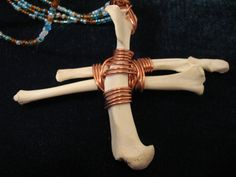 Wire Wrapped Raccoon Bone Necklace by BijouDreamworks on Etsy, $56.00