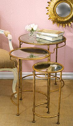 Two's Company Golden Bamboo Round Nesting Tables: A set of three round nested side tables with antiqued mirrored tops.  Crafted of golden bamboo metal.  Perfect for a small space to add dimension and to hold a glass.  10 1/2