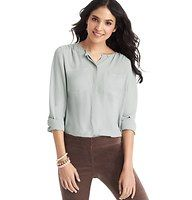 Collarless Utility Blouse - Styled collarless for simplified chic, this shirred utility blouse is our favorite go-to for breezy polish. Jewel neck. Long sleeves. Shirred forward shoulder seams. Patch pockets. Covered button front. Button cuffs. Back yoke with shirred detail.