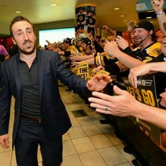 6/11/13 Brad Marchand gives a smile as he heads down the fan sendoff line...
