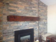 Faux knotty alder mantel. Design and fabrication by Glueks Custom