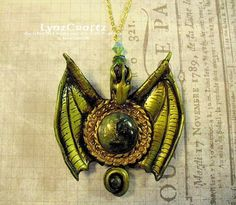 Dragon in Gold & Green polymer clay pendant necklace by LynzCraftz,