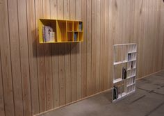 ALIGN : Satoshi Yoshida / Designer  -  Most bookshelves are designed for bigger-sized books, leaving empty space behind the smaller books. ALIGN is an extraordinarily narrow bookshelf which allows the alignment of both small and big books harmoniously & efficiently w/in the various angled partitions.