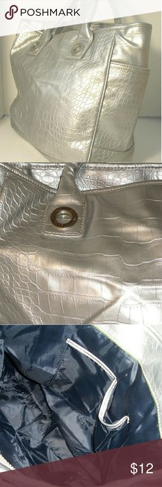 *TOMMY HILFIGER * Silver Ladies Totes Bag Silver metallic  Faux Crocodile material  In good condition  Very clean on the inside and outside   Measurements: 12 inches long 12 inches across 5 inch bottom  1 zipper compartment and 2 cellphone pockets Tommy Hilfiger Bags Totes