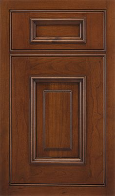 Joliet Raised door style by #WoodMode, shown in Fireside finish with Black glaze on cherry.