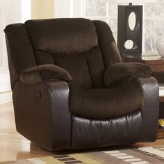 Ashley Tafton Java Rocker Recliner - With the rich brown tones of the soft upholstery fabric and the faux leather upholstery beautifully blending together, the Tafton-Java upholstery collection features the comfort of chaise pad seating along with plush padded arms and divided backs to create the ultimate in comfort and style for your living area.