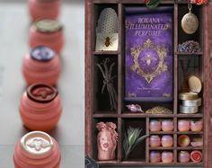 Illuminated Perfume https://www.etsy.com/listing/180463256/solid-perfume-sample-set-of-nineteen