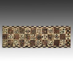 Tcaka or Dance Skirt, Mounted Kuba People Democratic Republic of Congo, Central Africa 20th C. Embroidered and Appliqued Raffia Panels 29'' W x 90'' L