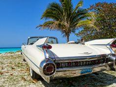 Classic 1959 White Cadillac Auto on Beautiful Beach of Varadero, Cuba