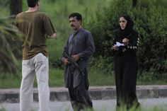 TENSE SITUATION: An armed man, his wife and their children, not pictured, spoke with authorities during a standoff that lasted for hours in Islamabad, Pakistan, Thursday. (T. Mughal/European Pressphoto Agency)