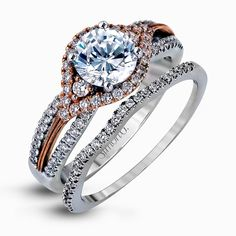 Featuring a modern design, this rose and white gold engagement ring and wedding band is highlighted by .51 ctw of round cut white diamonds. Print Page