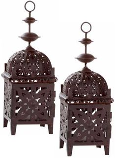 Metal Lantern Pair...Set of two Exotic metal candle lanterns. Place several together for an ever-changing display of dancing light!  $22.00