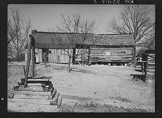 Dog-run log cabin in which Joe Handley, tenant farmer, lives. Walker County, Alabama. Taken by Arthur Rothstein in February 1937