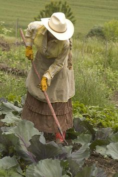 Gardening I like the colors and layering but would prefer a simple straw hat to the cowboy style one.