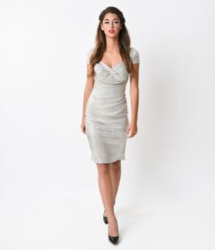 Larisa might be the most searched for dame at the soiree, gals! The Larisa dress from Stop Staring! is a stunning yet subtle 1950s frock, ideal as the ultimate in glamorous garb for any Holiday, New Years or fall fte! Crafted in a pale iridescent gold th