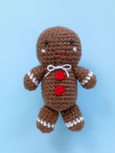 """Gleeful Gingerbread Friend"". Lion Brand Vanna's Choice yarn in Toffee (1 ball), Diamond (1 ball), & Ruby Red (1 ball). 4.25 mm/G crochet hook."