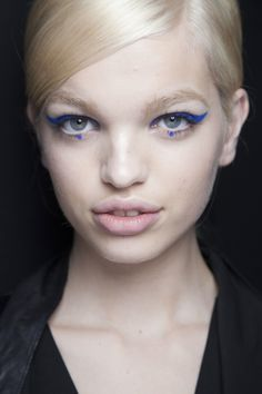Makeup artist Pat McGrath added little blue dots under models' eyes at Anna Sui.