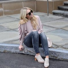 Love this blush ruffle sweater with these white mules.