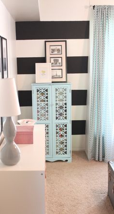 black and white striped walls, I will be doing this in my laundry room except maybe charcoal and white :)