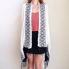 | new | fringe cardigan offers welcome new with tag white and black fringe trim cardigan with angled hem. available in size medium and large. •560998•  instagram: @xomandysue Sweaters Cardigans