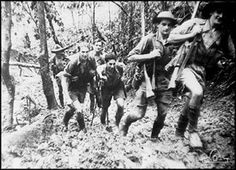 Young Militia soldiers of the Battalion returning to back down the Kokoda Track to their base camp after a battle at Isurava. Their shoes sink deep in the ozzing mud on the hilly jungle track. Japanese History, Anzac Day, Lest We Forget, The Weather Channel, United States Army, Second World, Writing A Book, World War Ii, Wwii