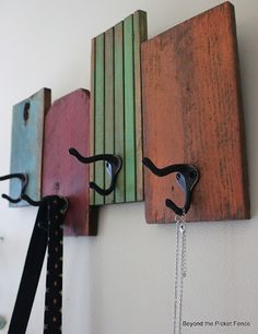 towel/ coat rack created from scrap wood I cut the wood into five same-sized pieces (I'm loving my miter saw) and anchored them to another piece of scrap wood.  I then added a length of chain for the hanger  could us hooks or old wooden knobs
