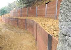Bildergebnis für how to build a retaining wall with sleepers Wooden Retaining Wall, Building A Retaining Wall, Retaining Walls, Back Garden Landscaping, Arbor Gate, Corten Steel, Steel Wall, Farm Gardens, Wood Wall